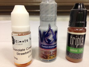 Some of the e-cigarette liquids for sale in N.C. today. Flavors, from left to right: watermelon, Irish cream and appletini. Photo credit: Rose Hoban