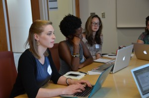 Caitlyn Snider, Adébukola Oni and Hyun Namkoong meet with potential capstone community partners. (Photo by Linda Kastleman)