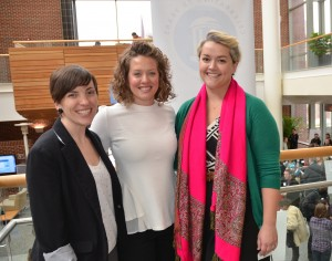Meg Landfried (left) poses with capstone teaching assistants Melissa Cox (center) and Christine Agnew-Brune during a final presentation of team projects. (Photo by Linda Kastleman)