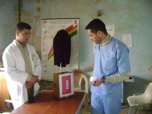 Between 2010 and 2013, Dr. Jaff regularly visited primary health-care centers in disputed areas of Iraq to support staff members. Here, at a rural center low on supplies, he devises a disposal box for used needles from an empty medicine box. (Contributed photo)