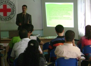 Dr. Jaff (standing) delivered a lecture in 2010 to a group of medical doctors and nurses in Iraq as part of a program to strengthen emergency services through training in communication and teamwork, infection control, waste management and other topics. (Contributed photo)